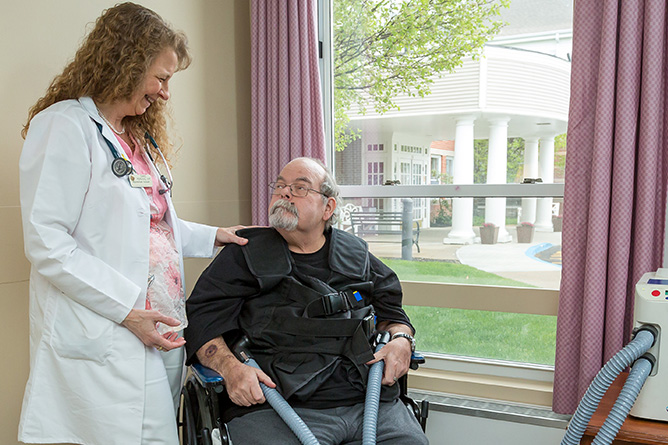 Respiratory Therapist helping man with respiratory care